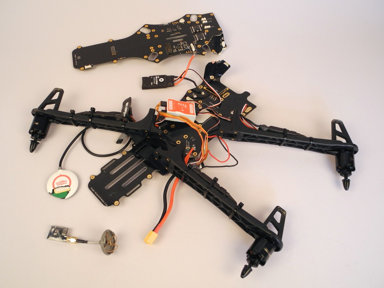 Some recovered parts after a crash. The copter fell apart, lost one arm and scattered into peaces.
