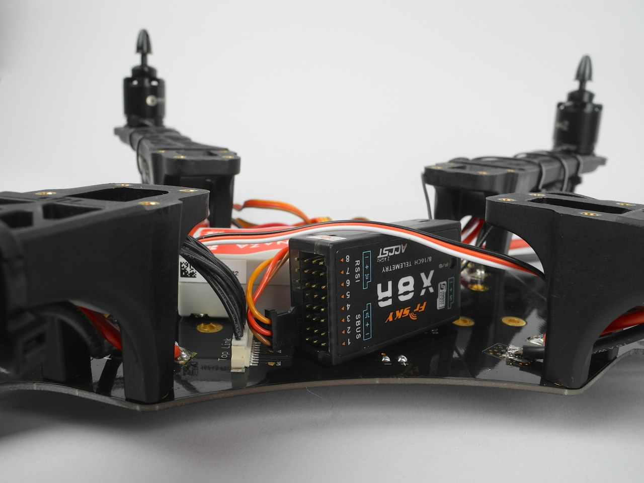 Closeup of the X8R lying sideways inside the frame.