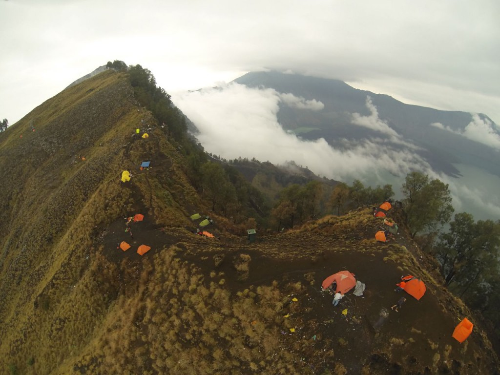Mount Rinjani, Indonesia in the clouds. Looking down from the crater rim over the camp site near Senaru.