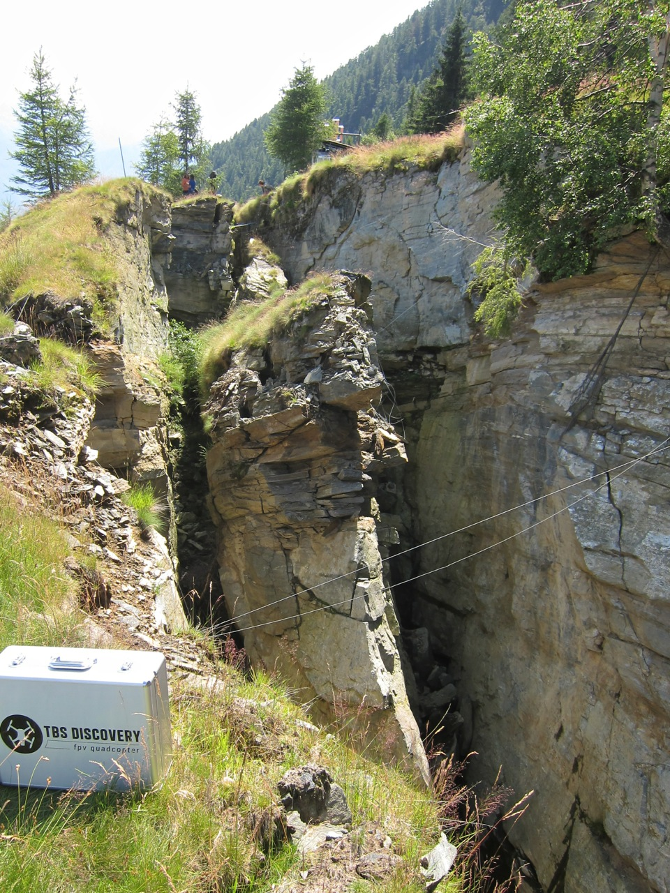 My Discovery case next to the cracks at the rupture zone of the landslide. The metal wires are crack meters.