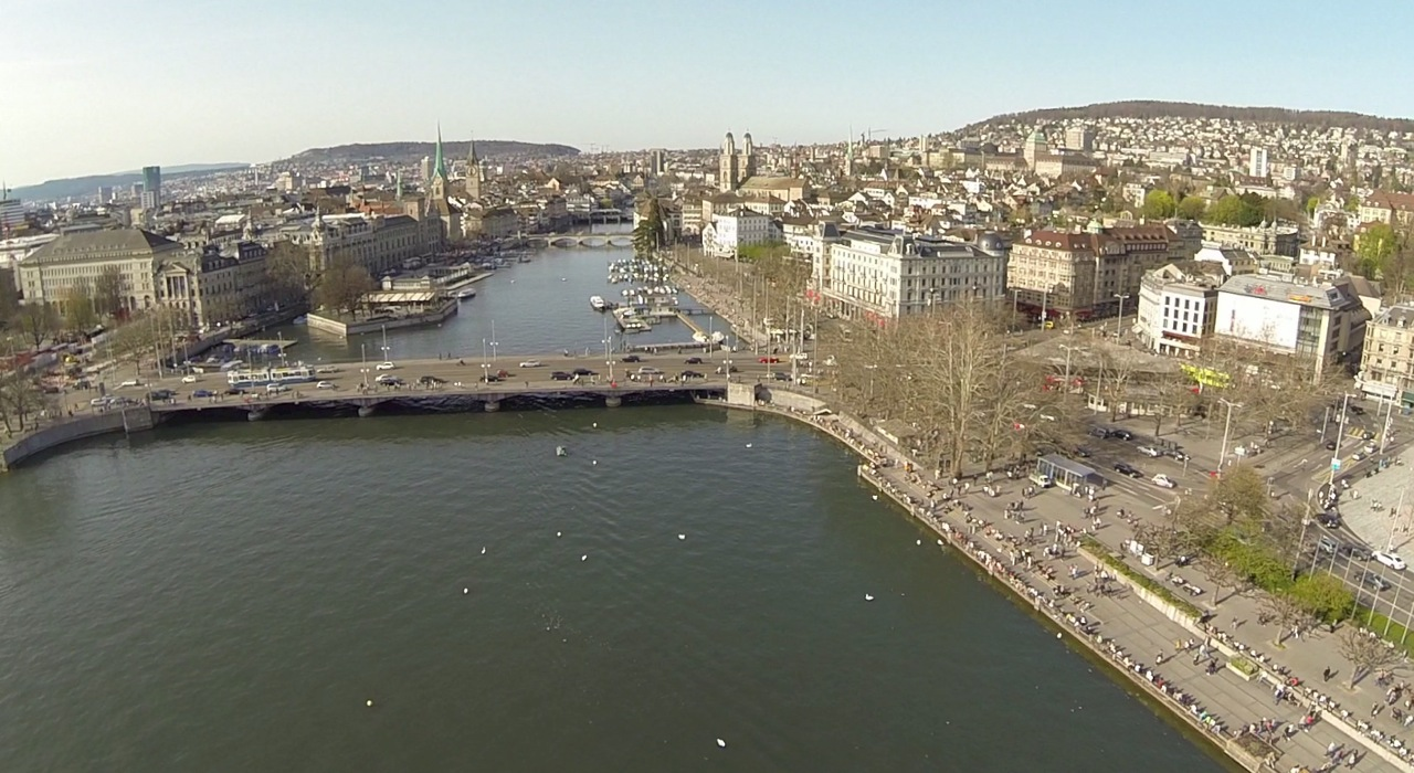 The skyline of Zurich with the Bellevue bridge and the Limmat in spring 2014.